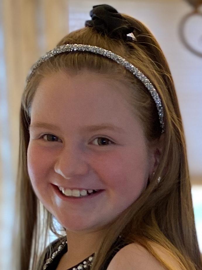 Smiling girl with glittery headband