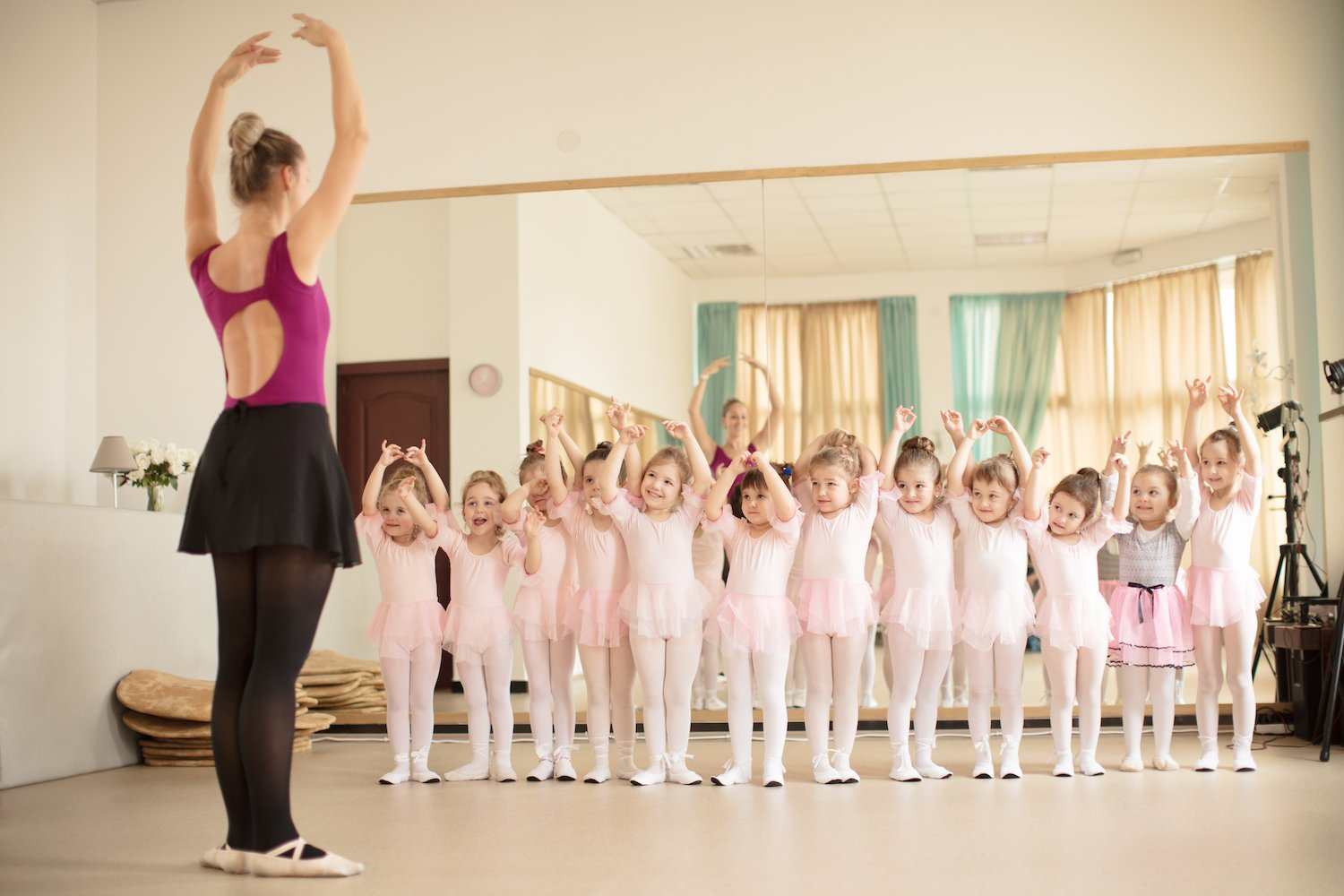 Young girls in a ballet class with adult instructor full size